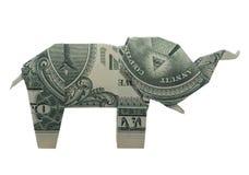 O ELEFANTE do olho do origâmi do dinheiro dobrou-se com um dólar real Bill Isolated no fundo branco imagem de stock