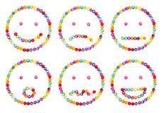 O Emoticon decora por gr?nulos coloridos Fotos de Stock Royalty Free
