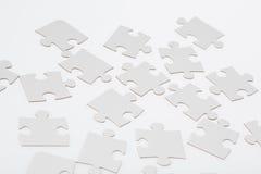 Partes brancas do enigma de serra de vaivém Imagens de Stock