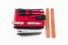 O equipamento utiliza ferramentas o fundo branco isolado da tosquiadeira de prego Fotografia de Stock