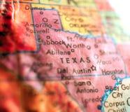 O estado do Texas EUA focaliza o tiro macro no mapa do globo para blogues do curso, meios sociais, bandeiras da Web e fundos imagens de stock