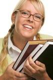 O estudante alegre carreg livros imagens de stock royalty free