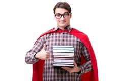O estudante do super-herói com os livros isolados no branco Foto de Stock Royalty Free