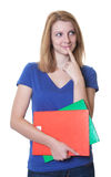 O estudante novo com cabelo e os livros vermelhos tem uma ideia Fotos de Stock