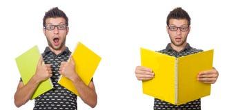 O estudante novo com livro e trouxa no branco Imagens de Stock