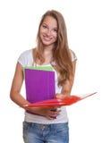 O estudante novo distribui seu documento fotos de stock royalty free