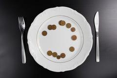 O Euro inventa o conceito comer do dinheiro Nada comer Comendo o dinheiro Fotos de Stock Royalty Free