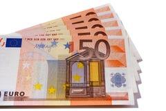 O Euro 50 notas da moeda isolou o branco Fotografia de Stock Royalty Free