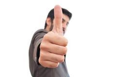 O executivo que mostra os polegares levanta a impressão Fotografia de Stock Royalty Free