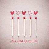 O fósforo de amor ardente com luz do fogo da forma do coração com expressão de você ilumina acima meu cartão do Valentim da vida Fotografia de Stock Royalty Free