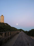 O farol e a lua Fotografia de Stock