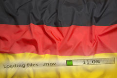 O fazendo download arquiva em um computador, bandeira de Alemanha Fotos de Stock