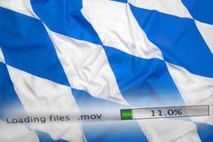 O fazendo download arquiva em um computador, bandeira de Baviera Fotografia de Stock