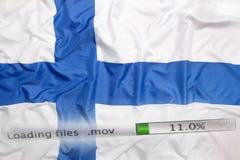 O fazendo download arquiva em um computador, bandeira de Finlandia Imagens de Stock