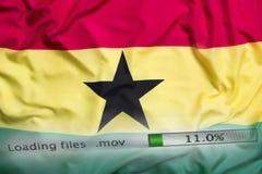 O fazendo download arquiva em um computador, bandeira de Gana Imagens de Stock Royalty Free
