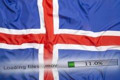O fazendo download arquiva em um computador, bandeira de Islândia Imagens de Stock
