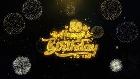 50.o feliz cumpleaños escrito las partículas del oro que estallan la exhibición de los fuegos artificiales