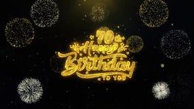 70.o feliz cumpleaños escrito las partículas del oro que estallan la exhibición de los fuegos artificiales