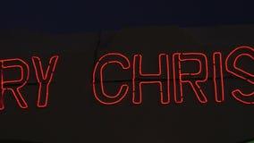 O Feliz Natal assina com luzes vermelhas de incandescência ilustração stock