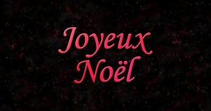 O Feliz Natal text no francês Joyeux Noel formado da poeira e das voltas para espanar horizontalmente filme