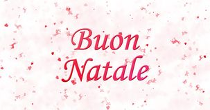 O Feliz Natal text no italiano Buon Natale formado da poeira e das voltas para espanar horizontalmente filme