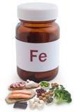 O ferro suplementa o conceito do frasco do comprimido Fotografia de Stock