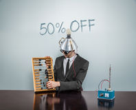 50 o ff -VB  off text on blackboard with businessman Stock Photo