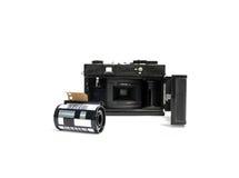 O filme retro da câmera e a câmera do cartucho filmam 35 milímetros Fotos de Stock
