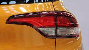 O fim acima da luz amarela da parte traseira do carro Imagens de Stock Royalty Free