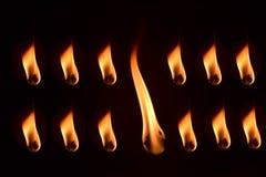 O fogo de lâmpadas de óleo tradicionais isolou a fotografia conservada em estoque Fotografia de Stock Royalty Free