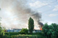 O fogo em um armazém Fotos de Stock
