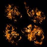 O fogo real arde as amostras isoladas no preto Imagem de Stock Royalty Free