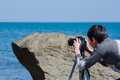 O fotógrafo atrás do trabalho fotos de stock