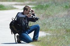 O fotógrafo escolhe foreshortening foto de stock