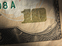 O fragmento da nota de dólar 10 Fotografia de Stock