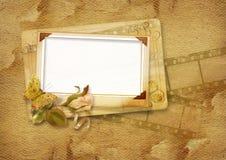O frame do vintage com filmstrip e levantou-se Imagens de Stock