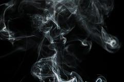 O fumo é uma coleção de relativo à partícula ínfima contínuos e líquidos transportados por via aérea Fotos de Stock