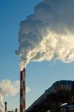 O fumo no céu azul Fotografia de Stock Royalty Free