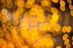 O fundo abstrato do bokeh do ouro circunda para o cartão de Natal Foto de Stock Royalty Free