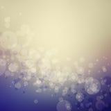 O fundo abstrato do bokeh em cores azuis e bege roxas com círculo dá forma Imagens de Stock Royalty Free