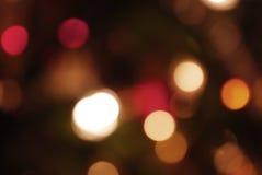 o fundo amarelo, escuro e vermelho com luzes de Natal boken dentro Imagem de Stock Royalty Free