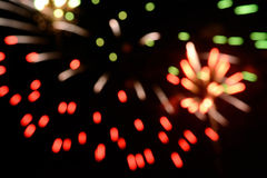 O fundo bonito do borrão dos fogos-de-artifício comemora dentro o isolado do dia no fundo preto Foto de Stock Royalty Free