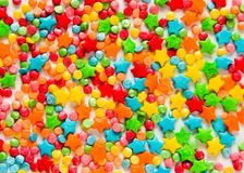 O fundo colorido do feriado com colorido polvilha imagens de stock