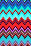 O fundo colorido colorido psicadélico da arte abstrato do teste padrão de ziguezague de Chevron tende fotografia de stock