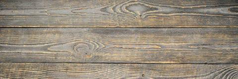 O fundo da textura de madeira embarca com os restos amarelos da cor da pintura cinzenta horizontal natalia imagens de stock royalty free