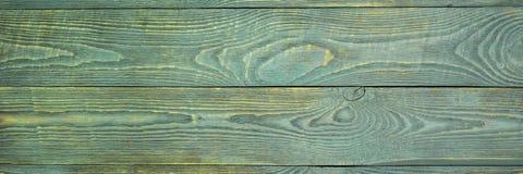 O fundo da textura de madeira embarca com os restos da luz - pintura verde natalia foto de stock