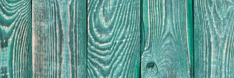 O fundo da textura de madeira embarca com um resto da pintura da cor verde vertical natalia foto de stock