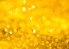 O fundo da textura dourada do brilho imagens de stock