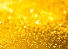 O fundo da textura dourada do brilho imagens de stock royalty free