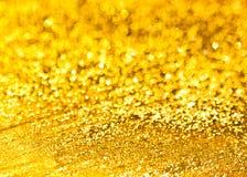 O fundo da textura dourada do brilho imagem de stock